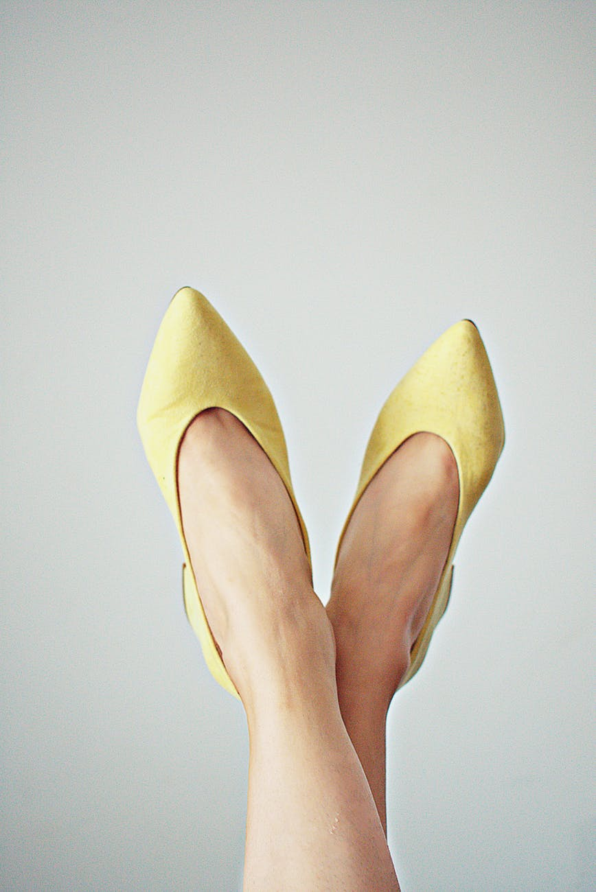 person wearing yellow shoes